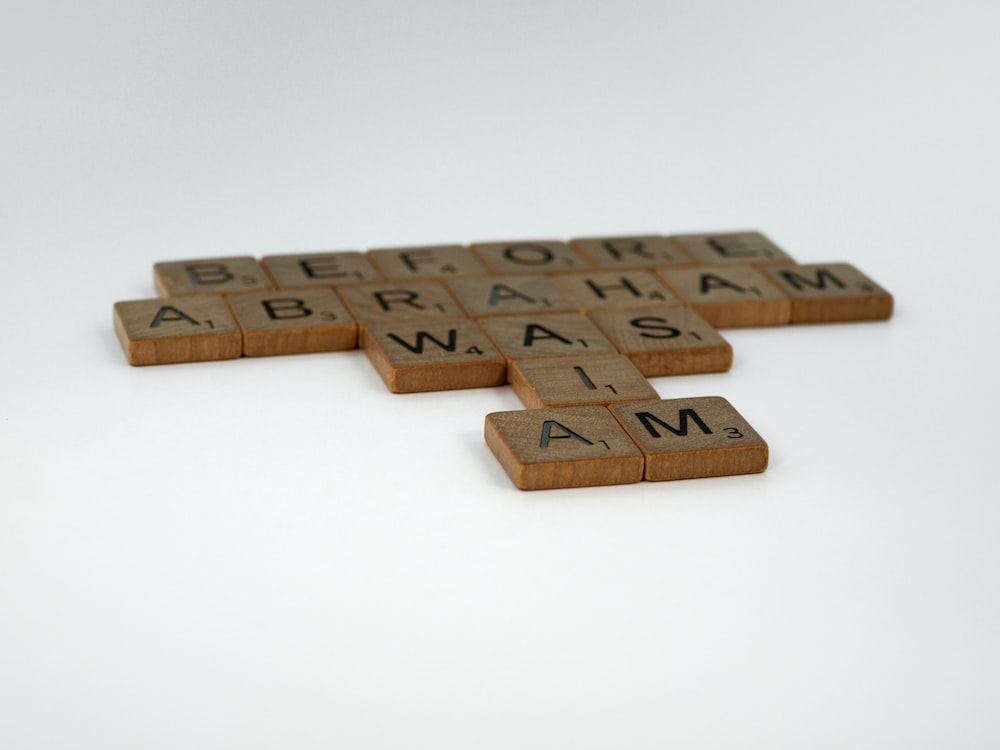 brown wooden letter t-wall decor