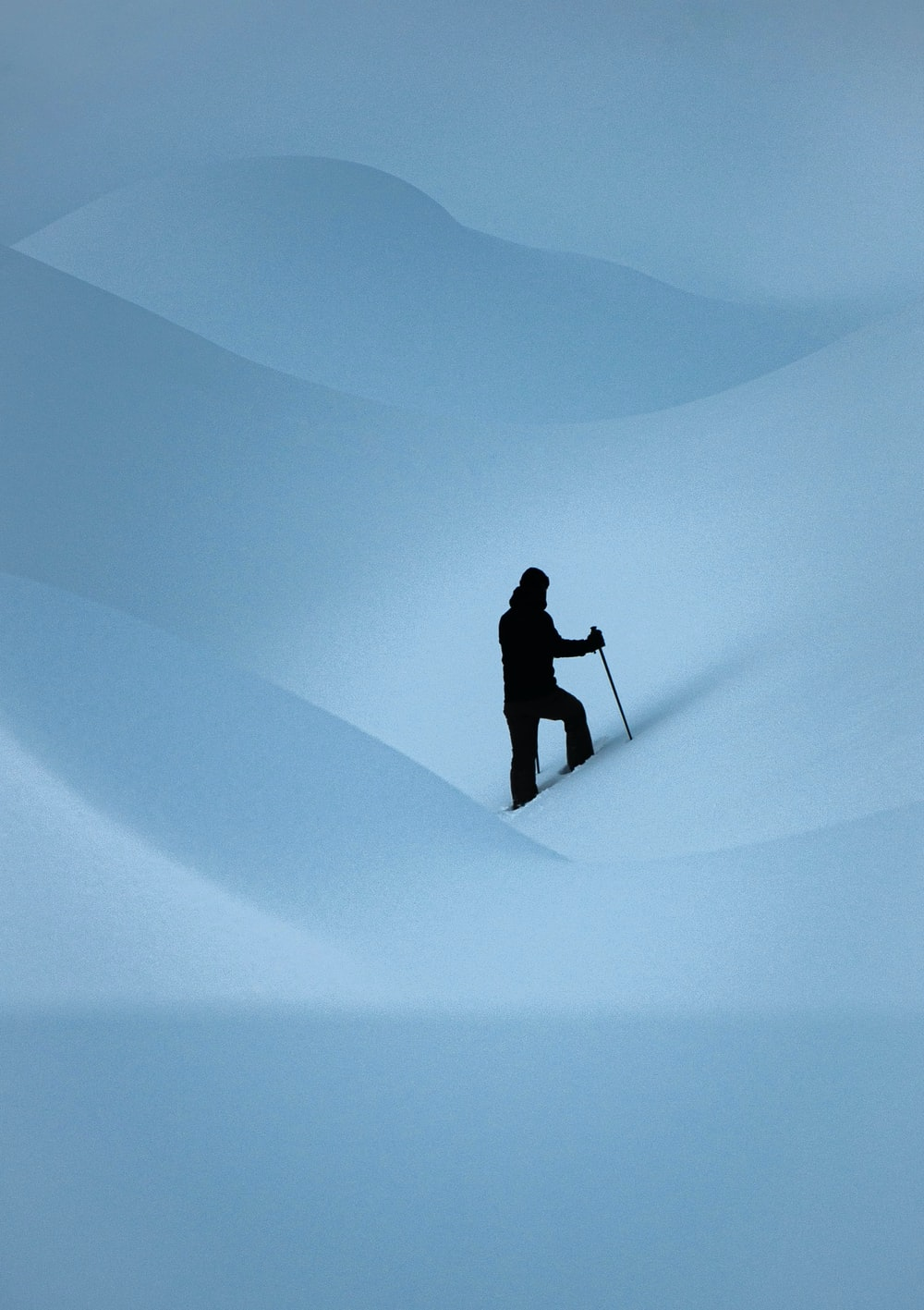 silhouette of man walking on desert
