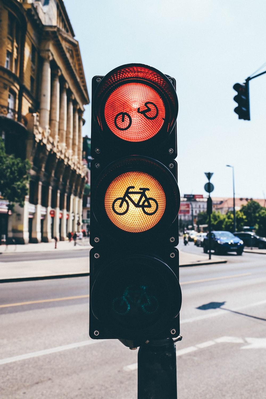 black traffic light on red stop light
