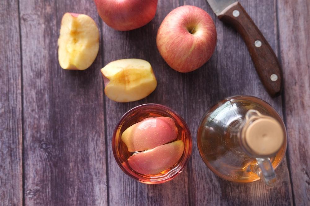 sliced apple beside black handled knife