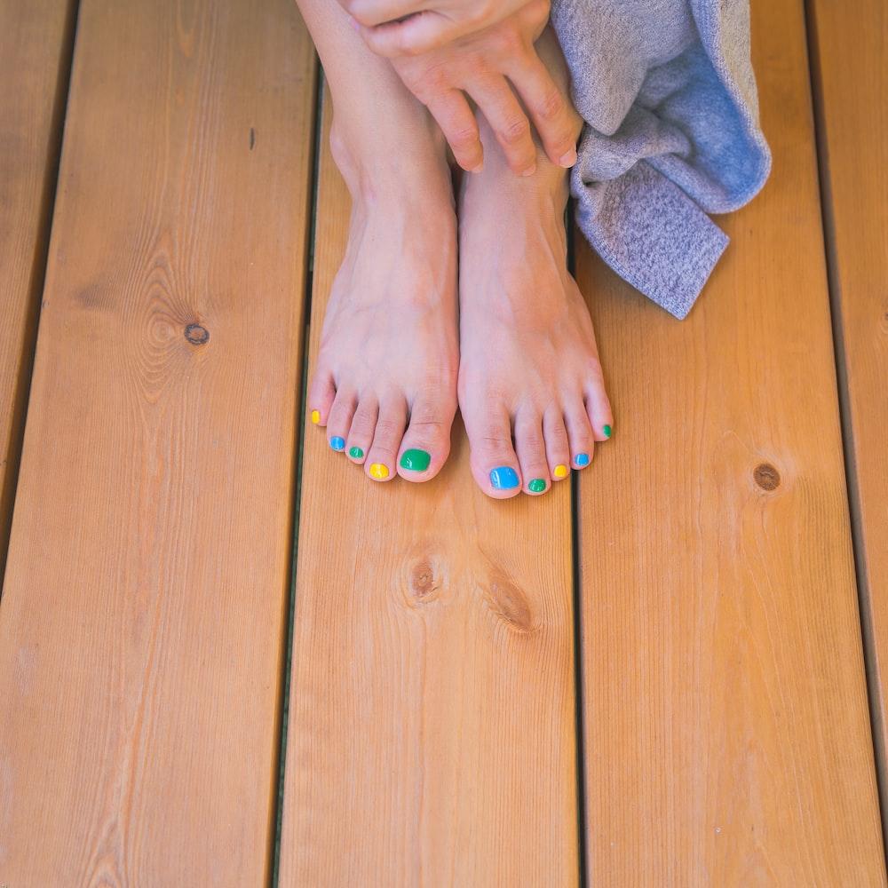 person with orange nail polish