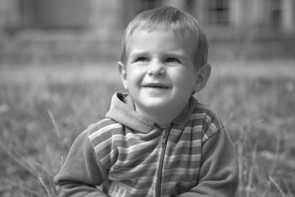 grayscale photo of boy in zip up hoodie