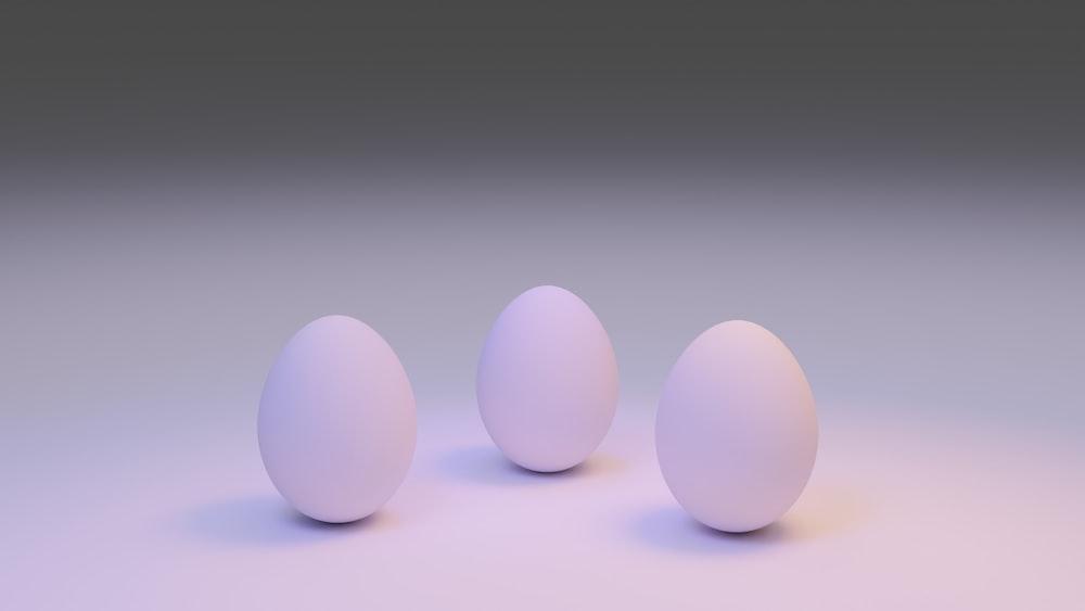3 white eggs on white surface