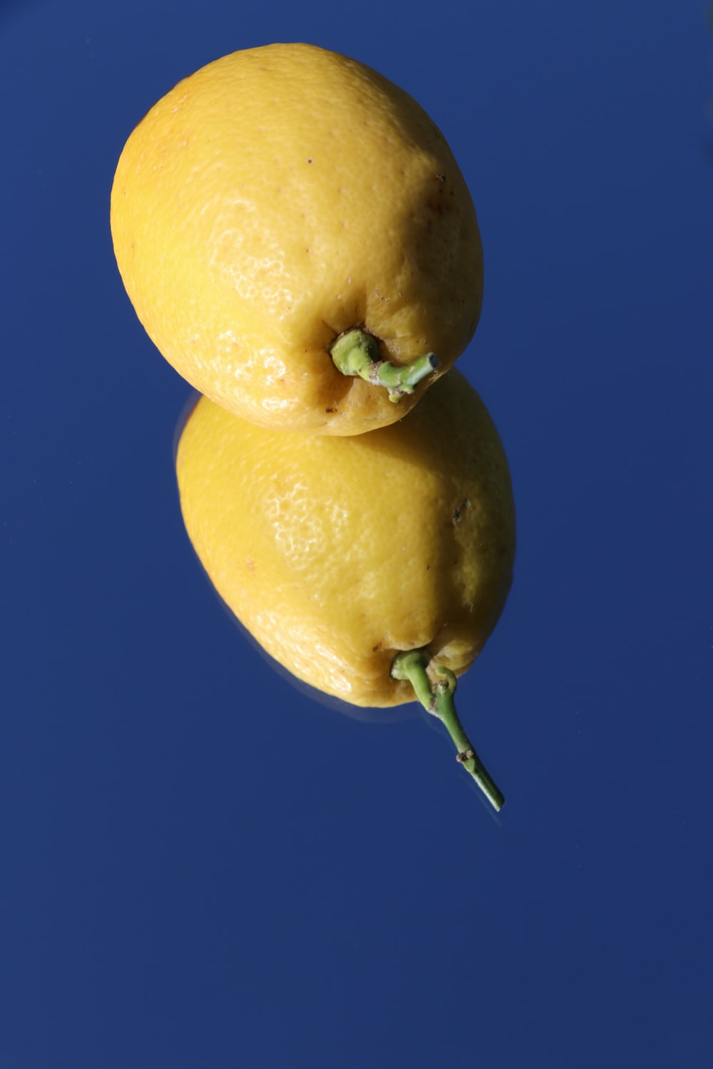 yellow fruit with blue background