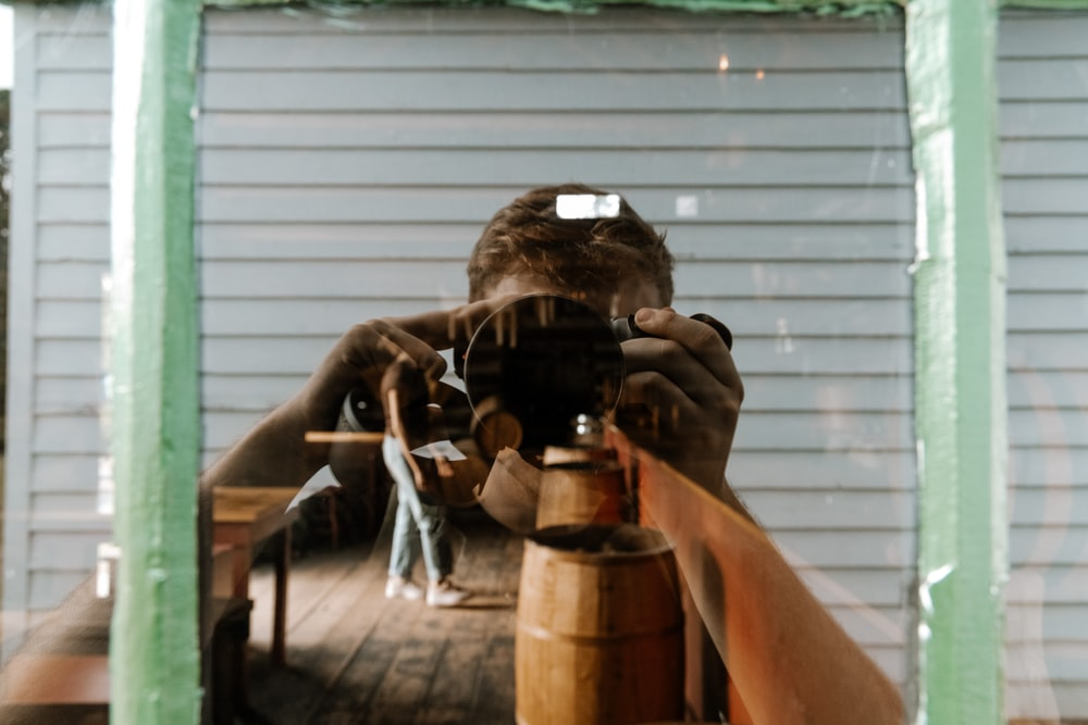 man taking photo of a man using a camera