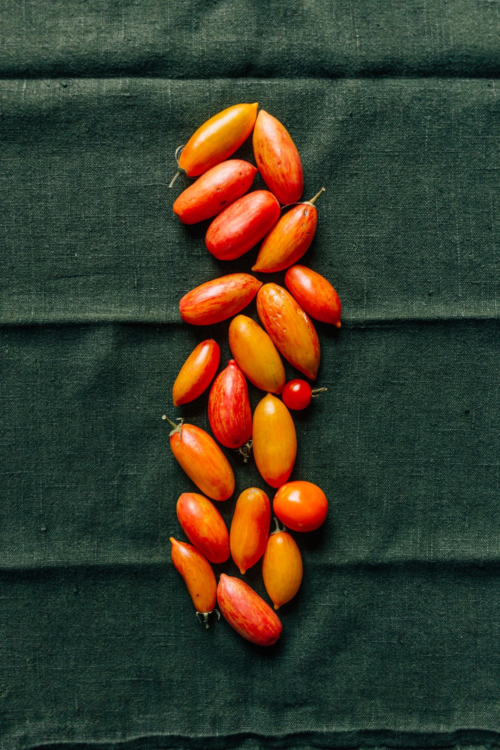 red and brown beans on black textile