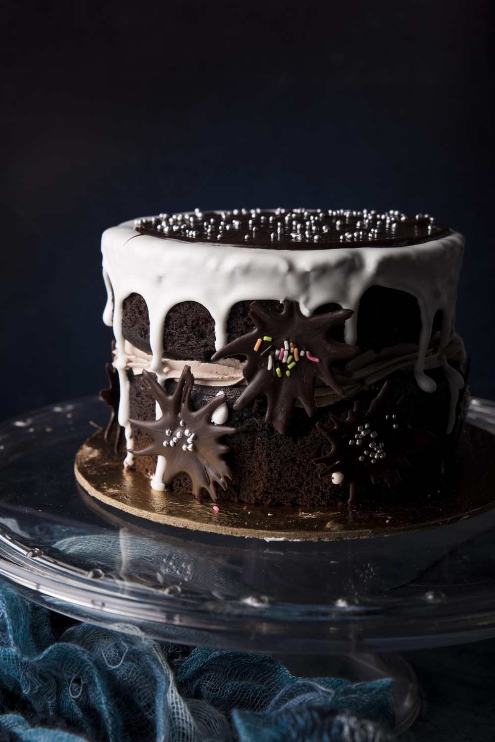 white and black cake on blue glass plate