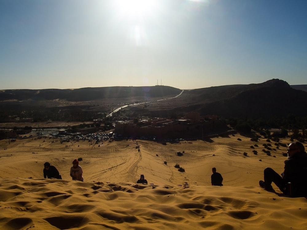 people on desert during daytime