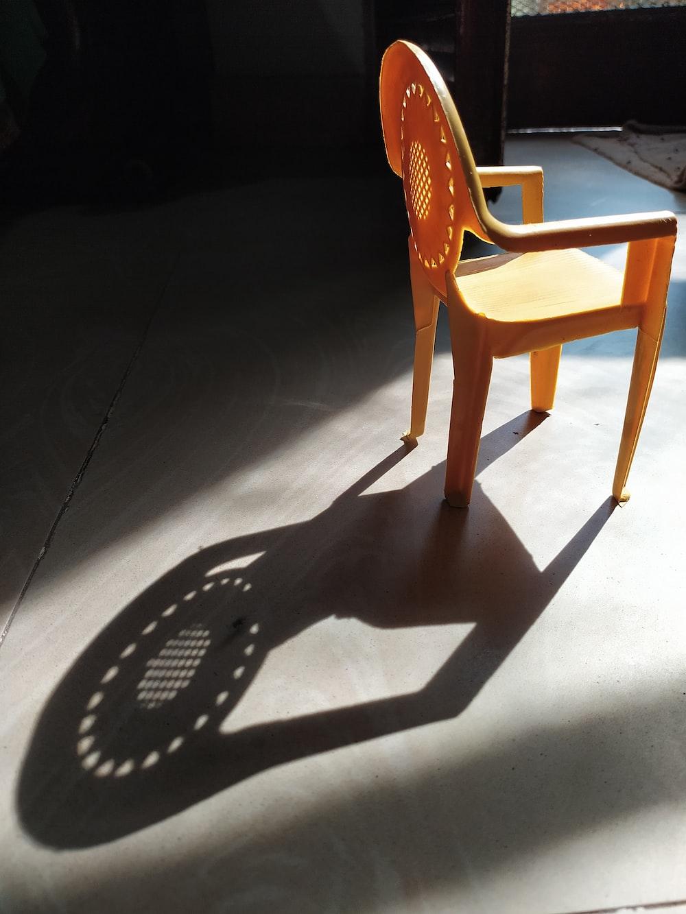 brown plastic armchair on gray floor