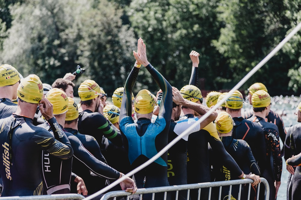 group of people wearing blue and yellow helmet