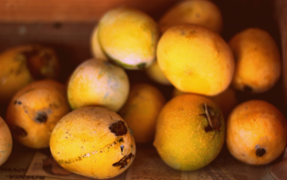 yellow round fruits on brown wooden table