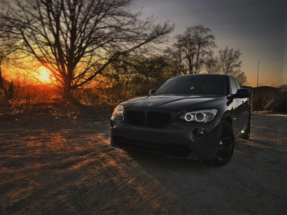 black bmw car on road during sunset