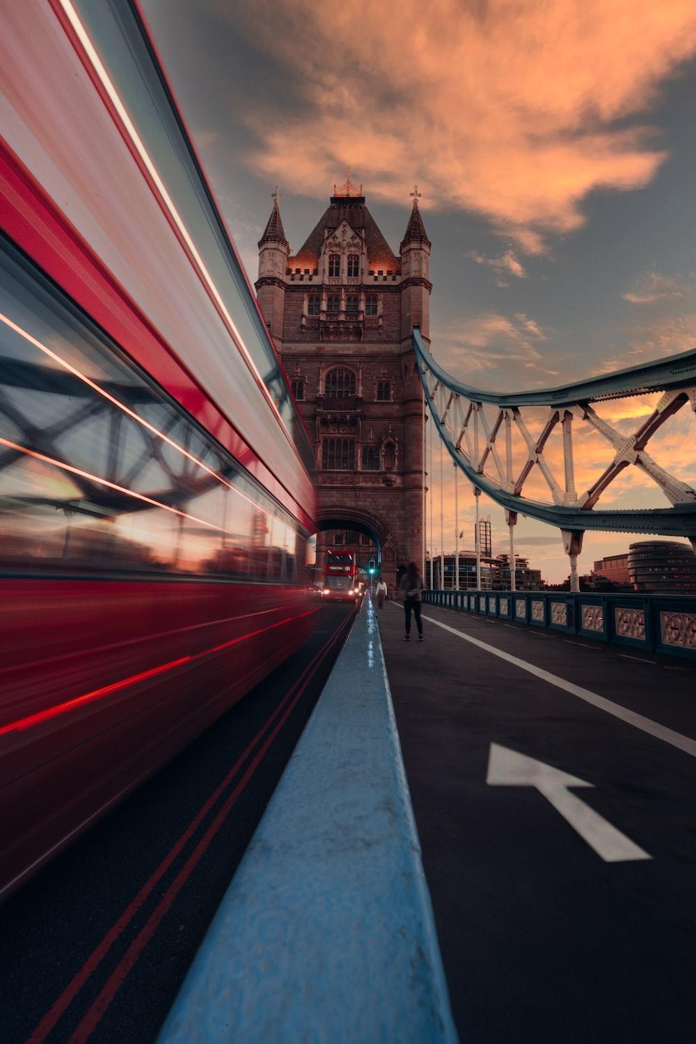people walking on bridge during night time
