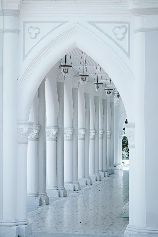 white concrete hallway with white columns