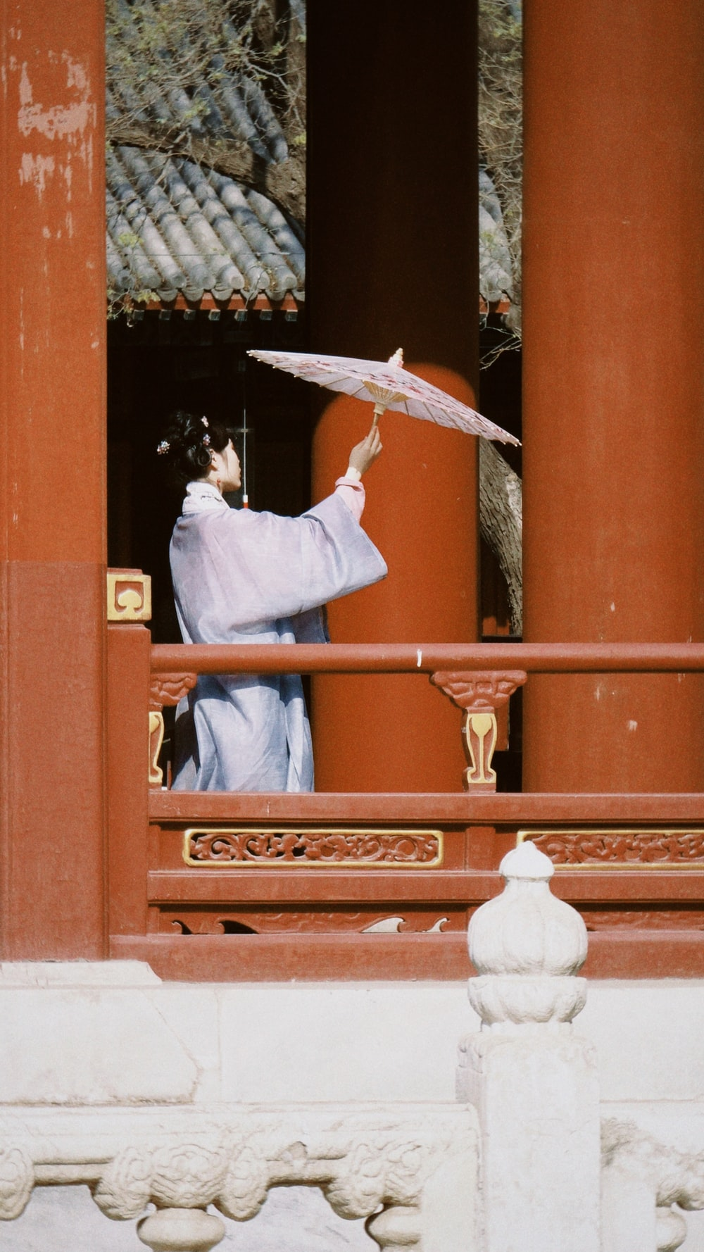 man in white thobe holding umbrella