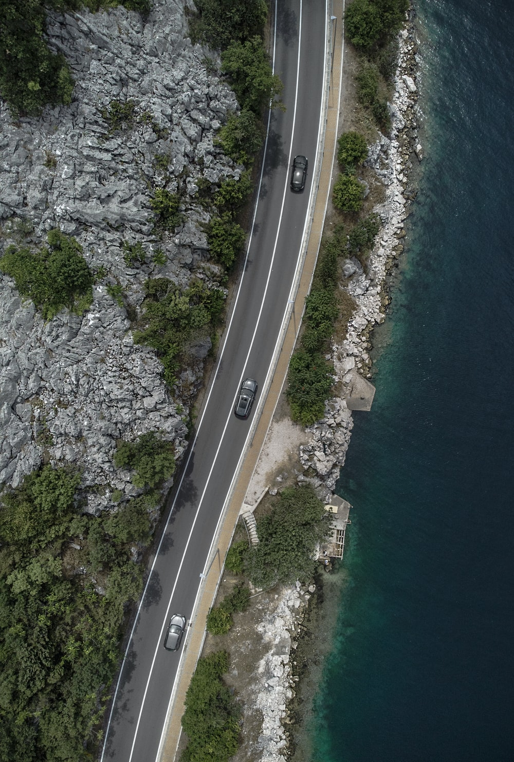 aerial view of a road near the body of water