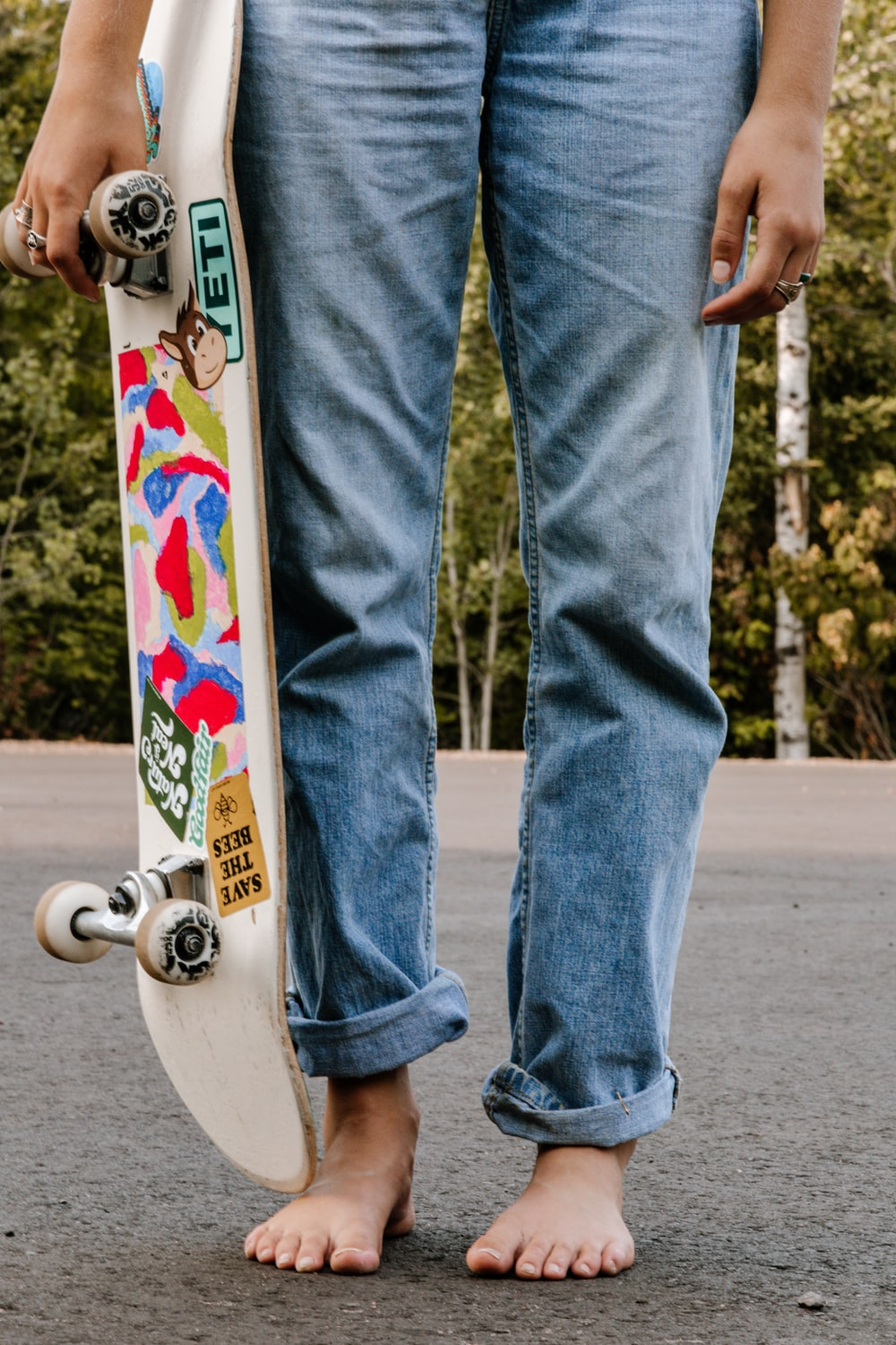 person in blue denim jeans riding skateboard during daytime