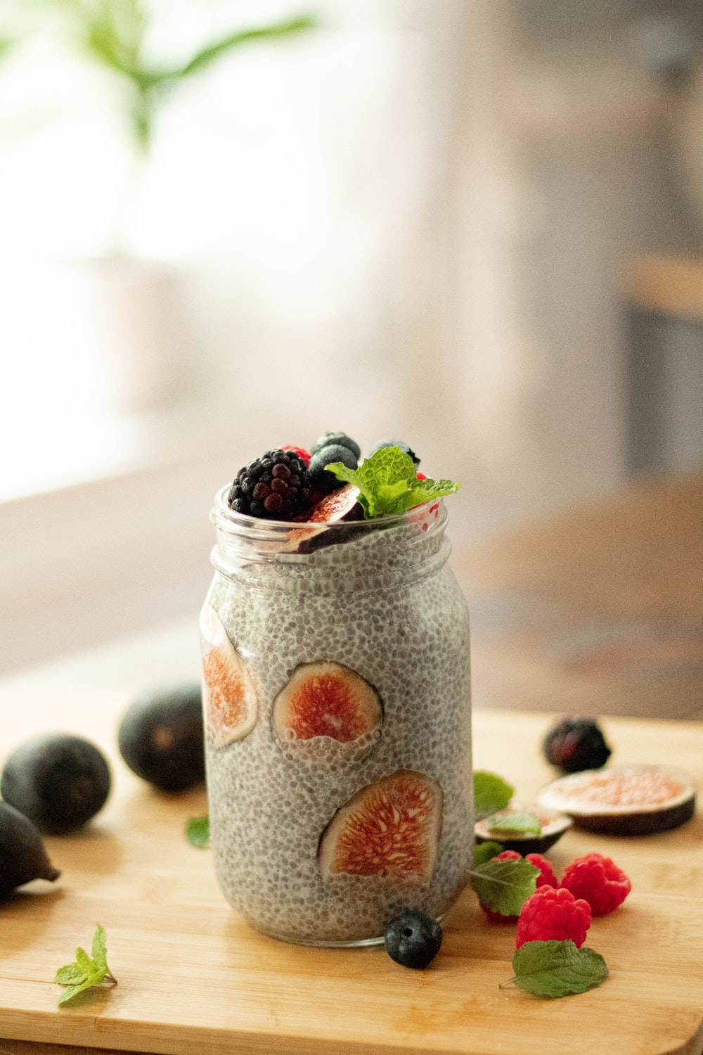 raspberry and blueberry in clear glass cup