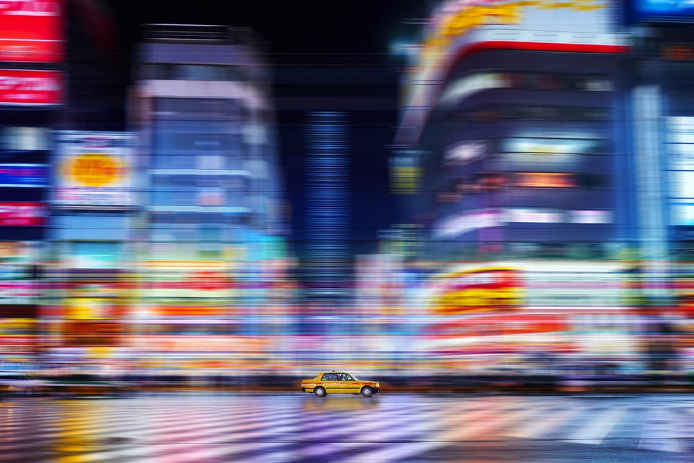 yellow car on road during night time