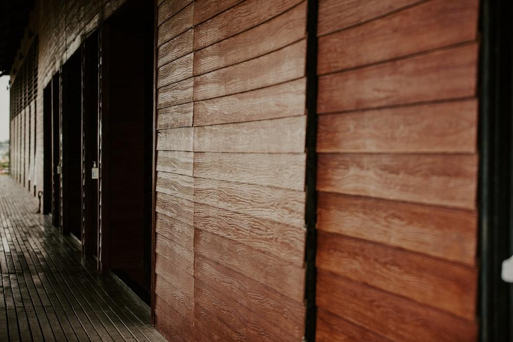 brown wooden door near black wooden door