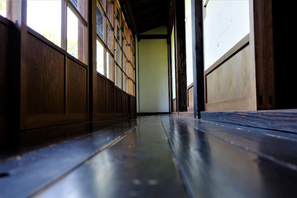 brown wooden door on gray concrete floor