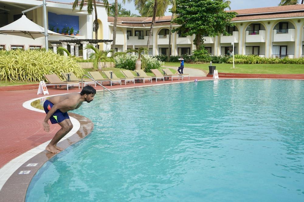 woman in blue bikini in swimming pool during daytime