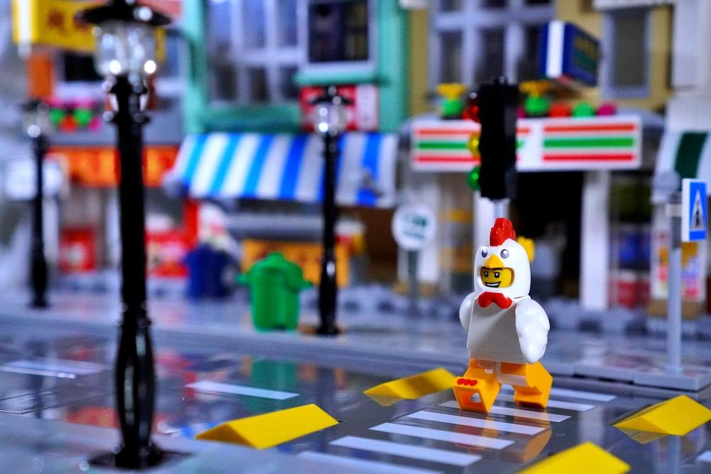 white and yellow lego toy