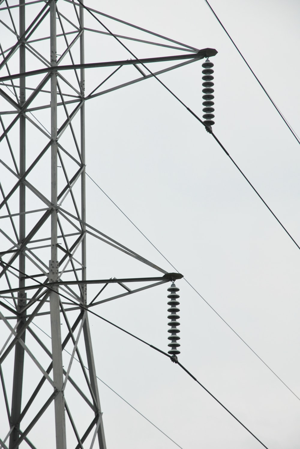 black metal electric tower under white sky
