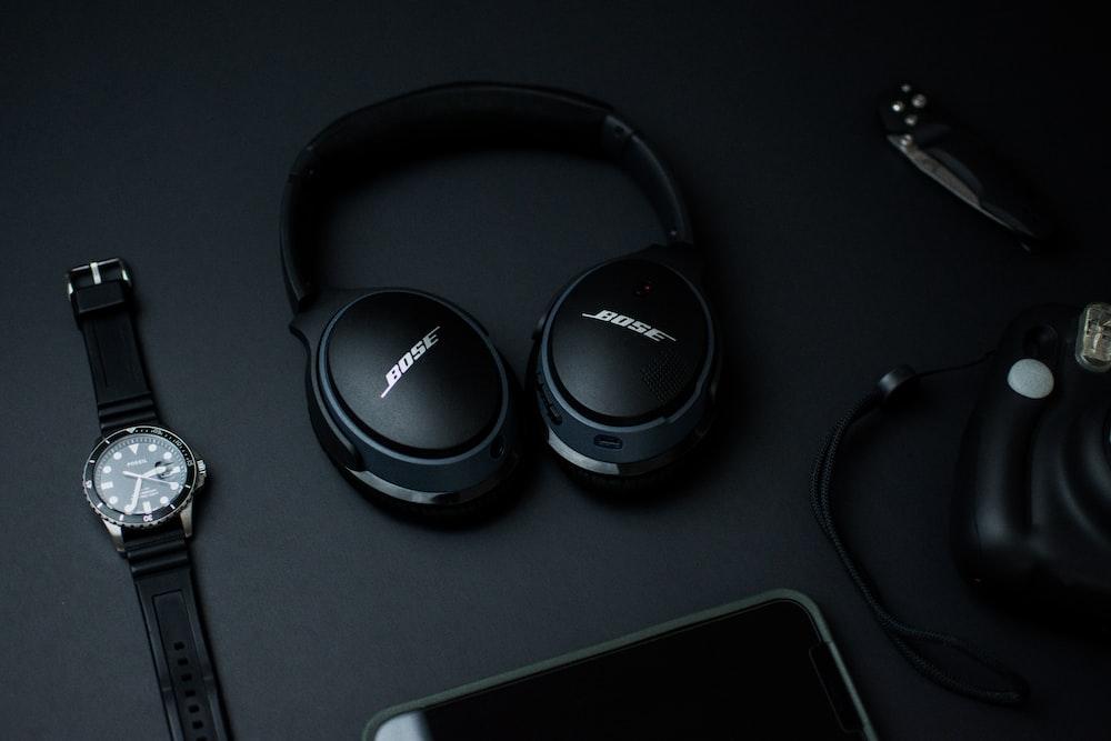 black sony headphones on black tablet computer