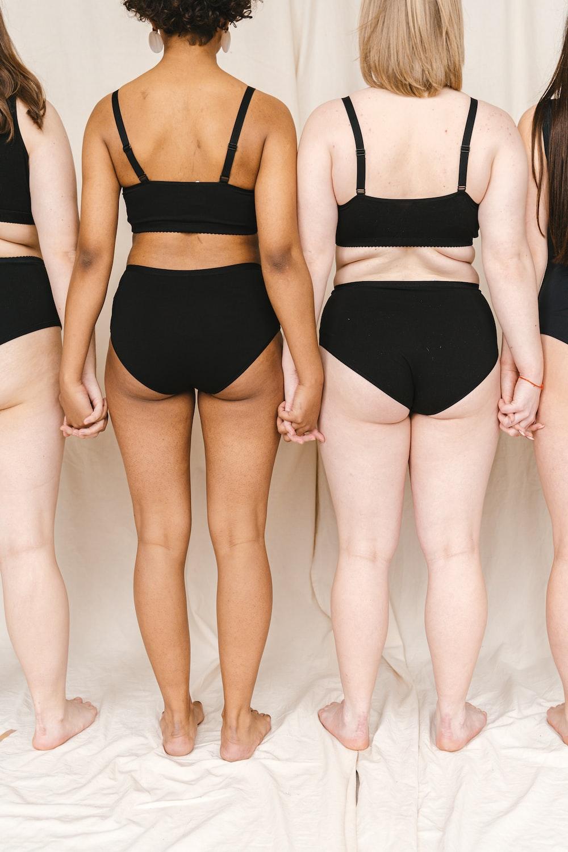 woman in black bikini bottom