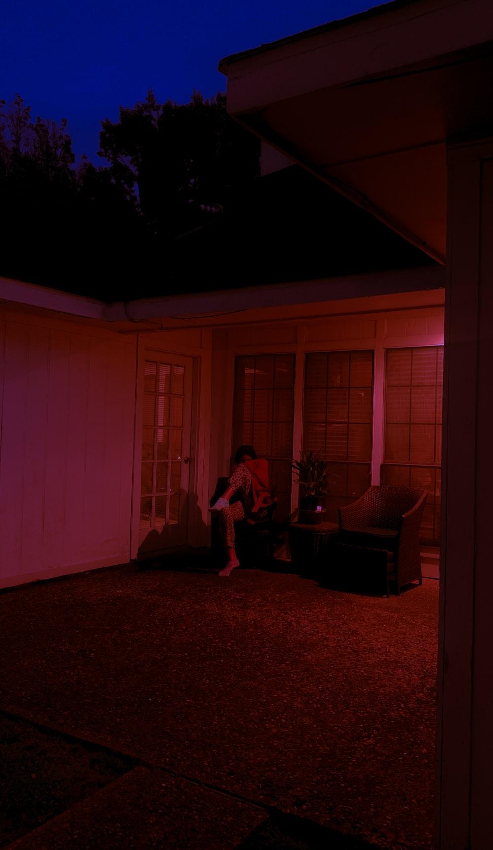 woman in pink dress standing near white wooden door