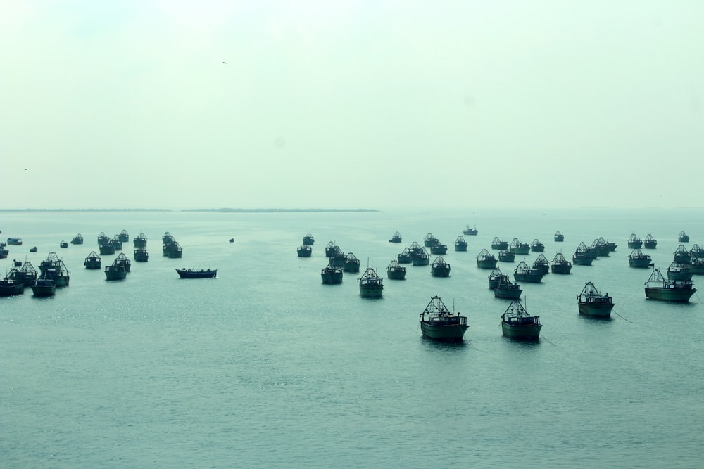 boats on sea during daytime
