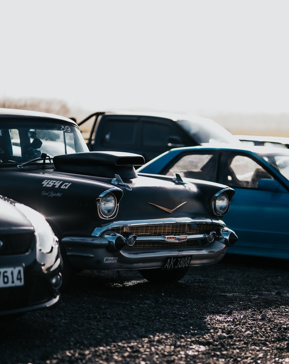 black and blue classic car on gray sand during daytime