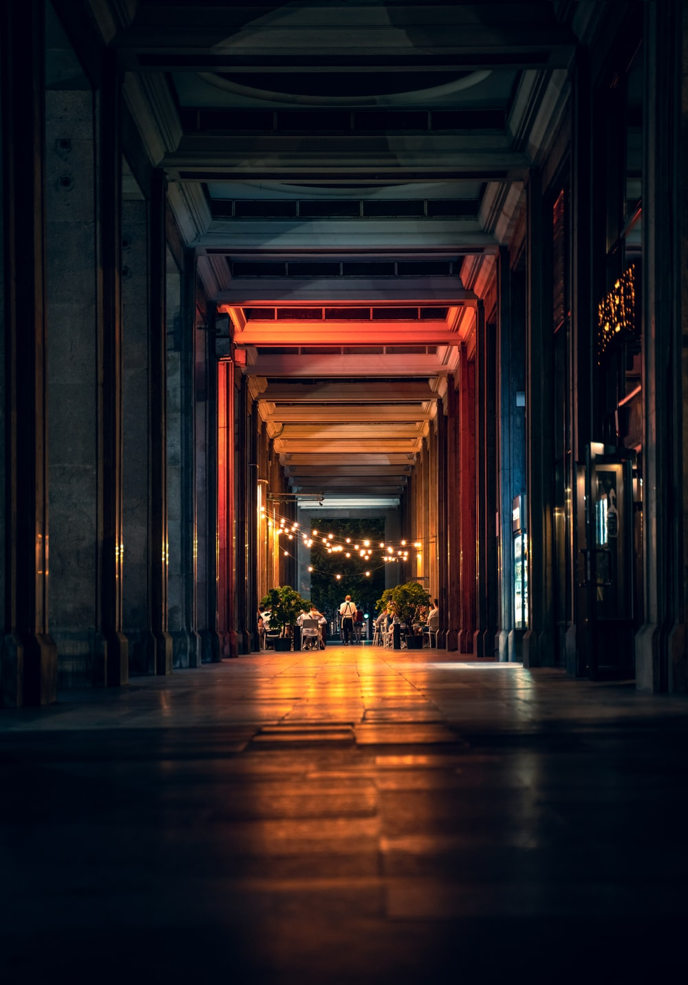 brown wooden hallway with yellow lights