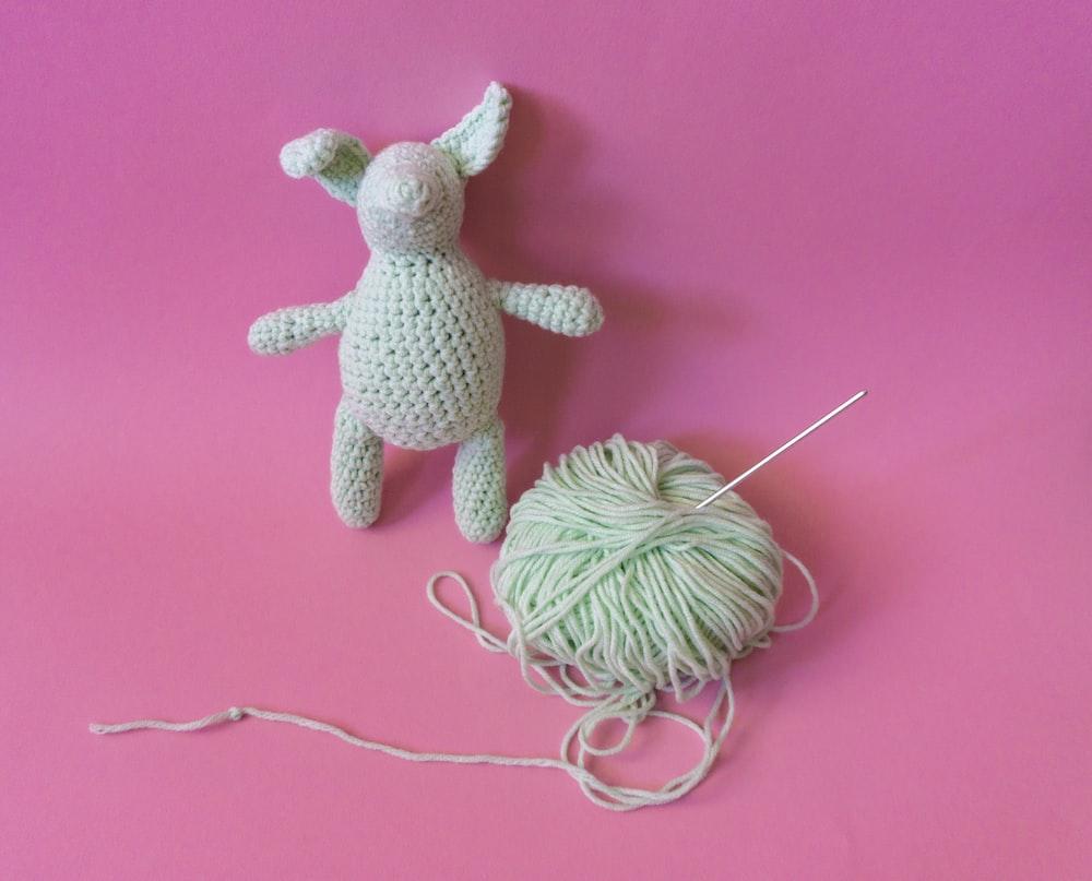 white and gray rabbit plush toy