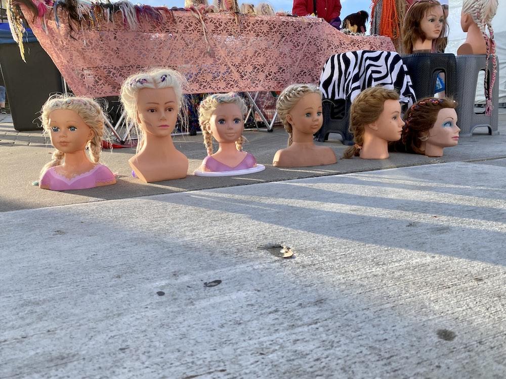 children sitting on gray concrete floor during daytime