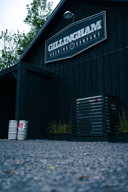 black wooden house with white plastic trash bin