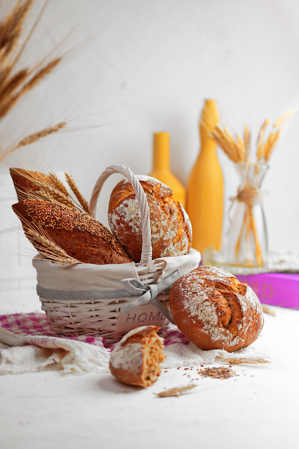 brown and white doughnuts on white basket