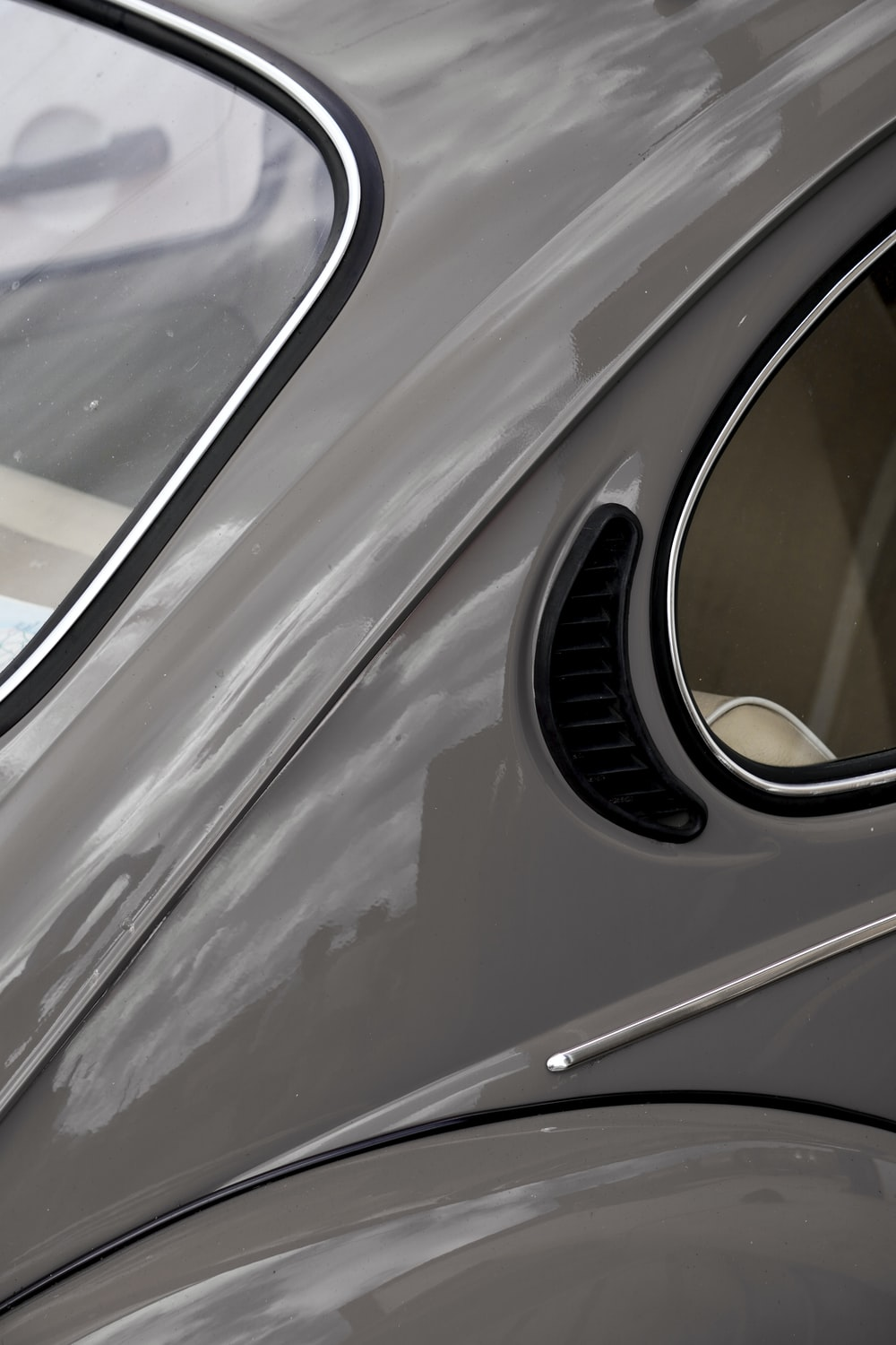 silver car with white and black car door