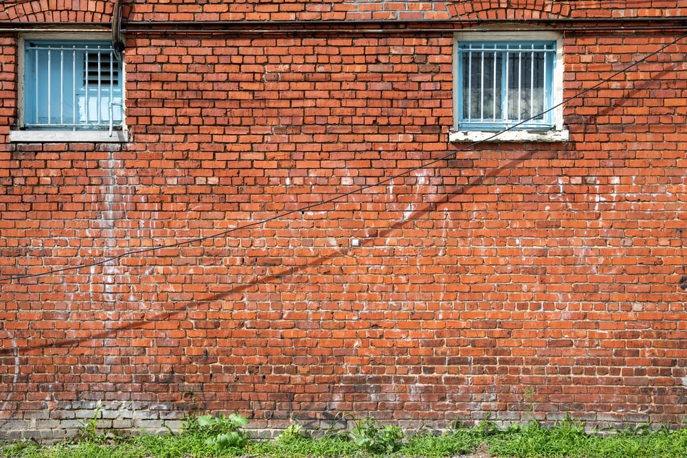 brown brick wall with white window frame
