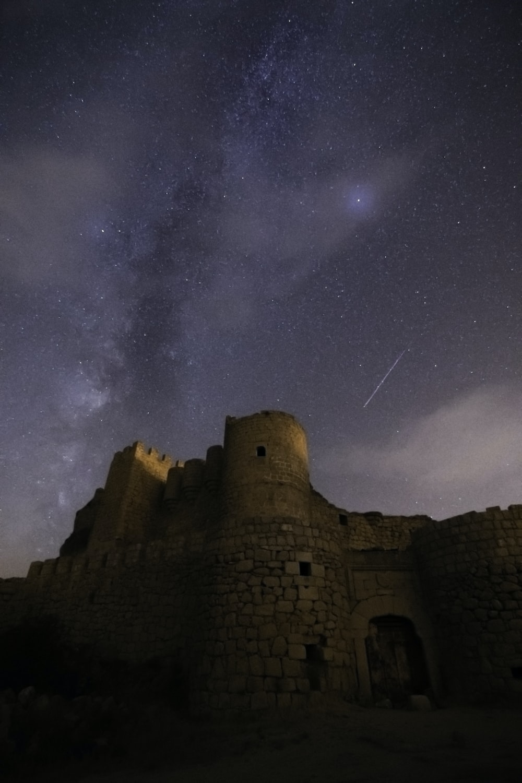 brown concrete building under starry night