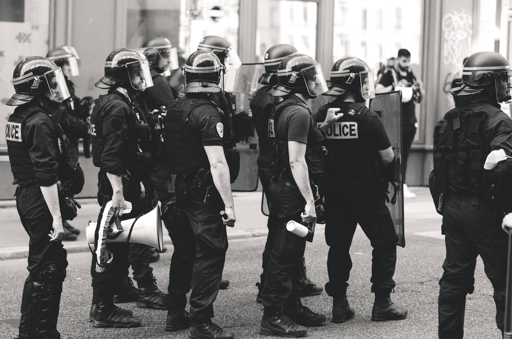 grayscale photo of men in police uniform