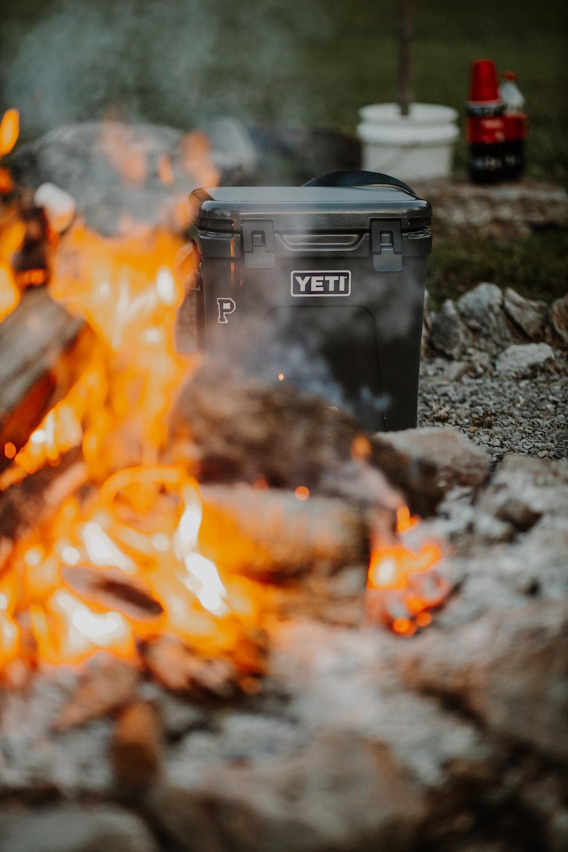 black plastic trash bin on fire