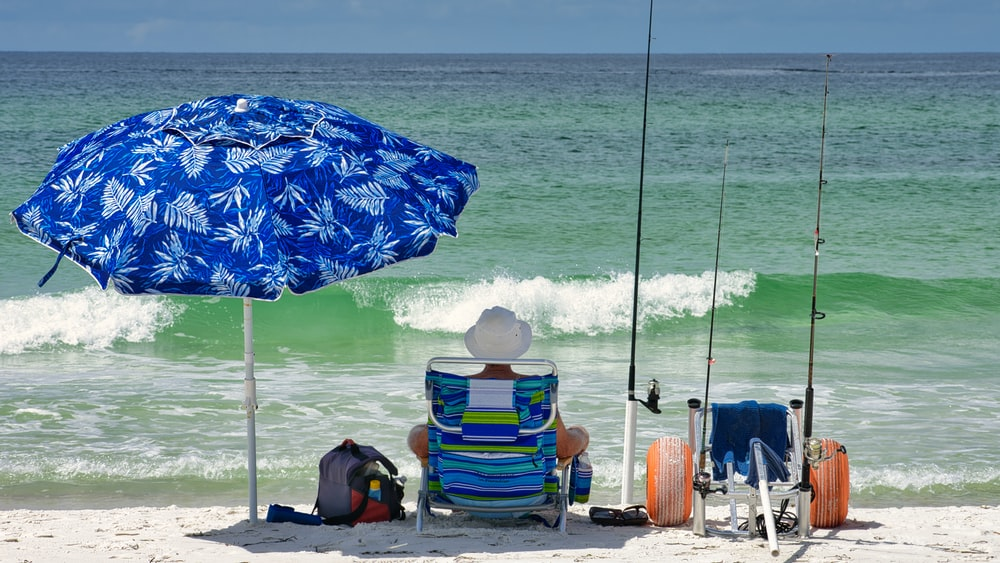 blue and yellow umbrella on beach