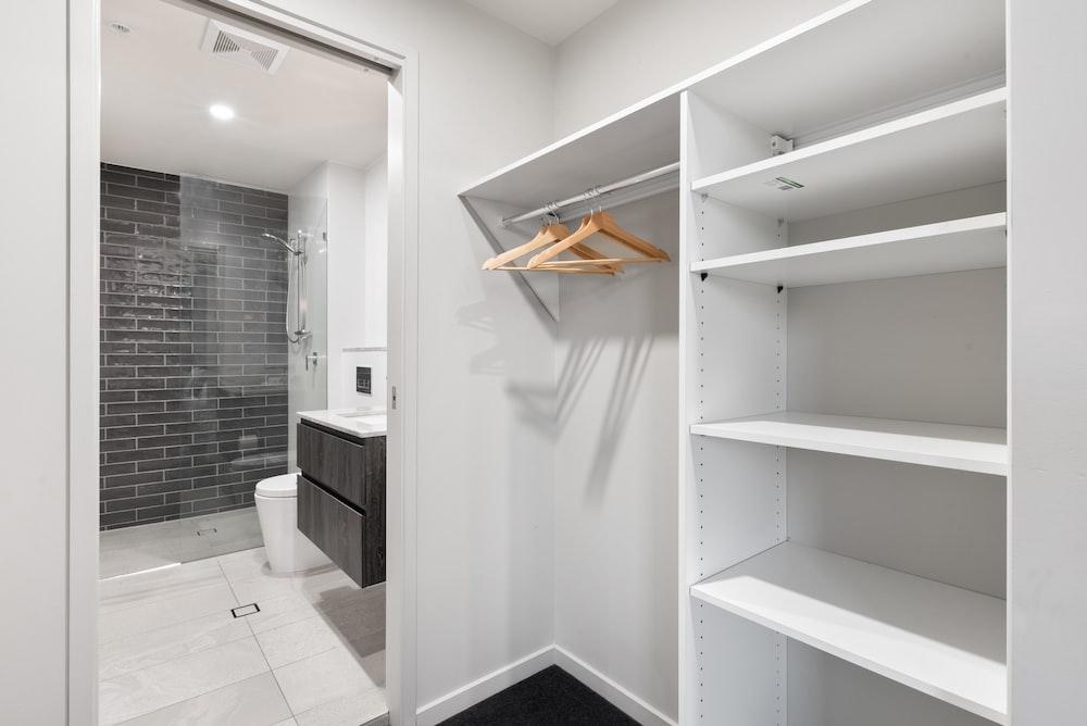 white wooden shelf with mirror