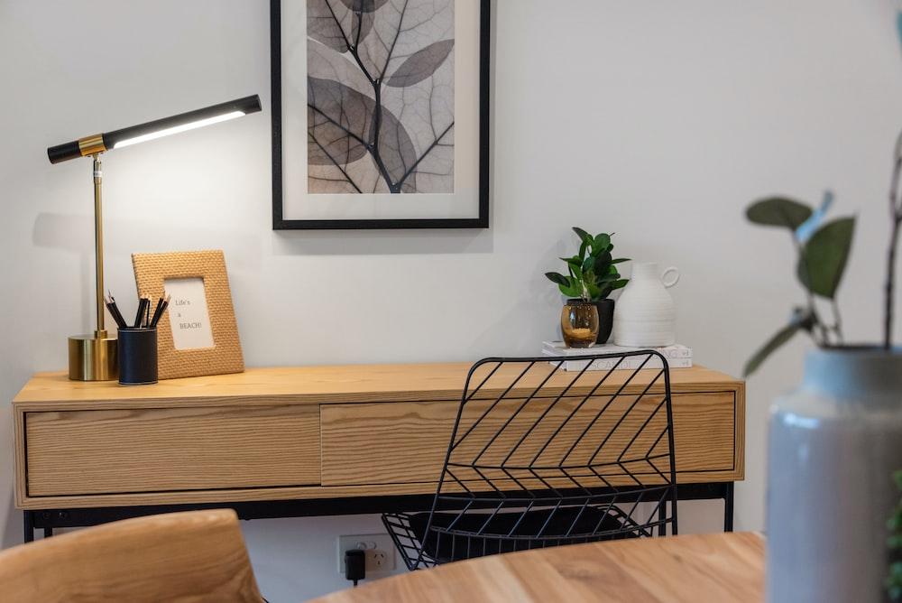 black metal framed white padded chair beside brown wooden table