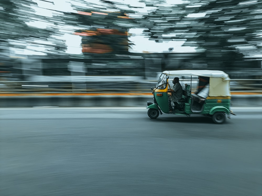 green and white golf cart on road during daytime