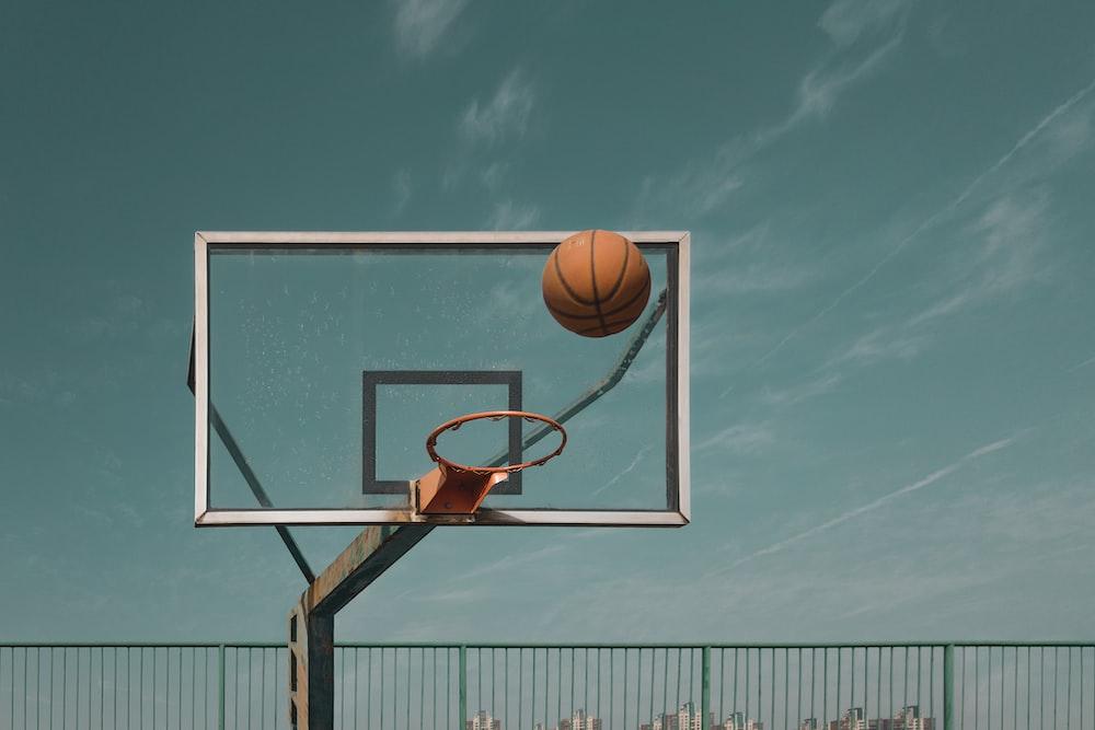 basketball hoop under blue sky during daytime