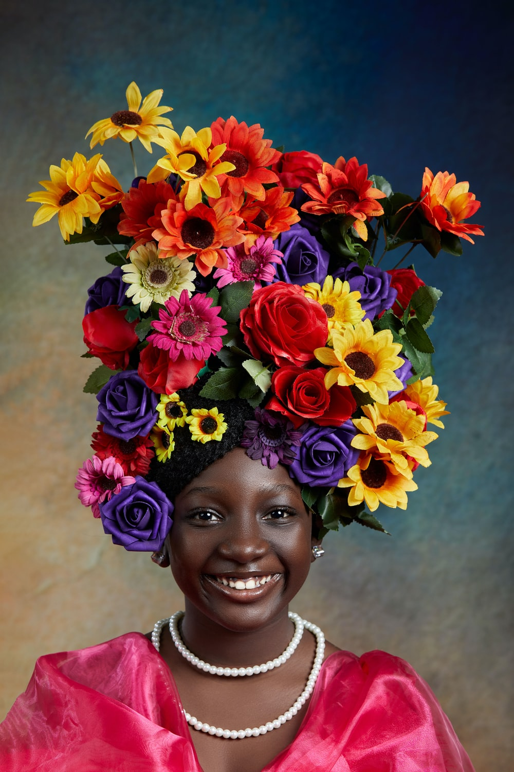 woman with red yellow and blue flower crown