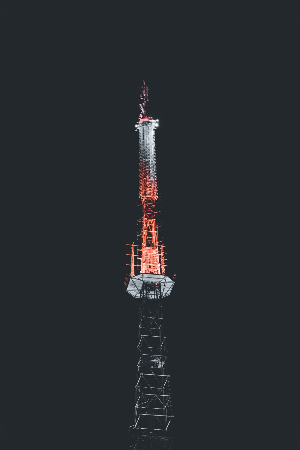 red and black tower with red light